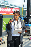 Camden Mayor Dana L. Redd reads a proclamation as Valerie Brown Traore, CEO (C) looks on at Hungerstock October 1, 2011 at Rivershark Stadium in Camden, New Jersey. The Food Bank of South Jersey held the event to raise money to feed hungry families in New Jersey. (Photo by William Thomas Cain/cainimages.com)