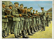 German re-armament and militarisation:  German infantrymen lined up for boot inspection.   From series of 270 cigarette cards 'Die Deutsche Wehrmacht', Dresden, 1936.