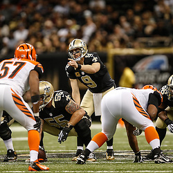 Nov 16, 2014; New Orleans, LA, USA; New Orleans Saints quarterback Drew Brees (9) against the Cincinnati Bengals during the second half of a game at the Mercedes-Benz Superdome. The Bengals defeated the Saints 27-10. Mandatory Credit: Derick E. Hingle-USA TODAY Sports