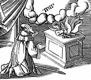 King David making a burnt offering to God in thanks for the deliverance of the Israelites from plague. The name of God (Jehovah) is written in the clouds/ Woodcut from a 16th century 'Bible'