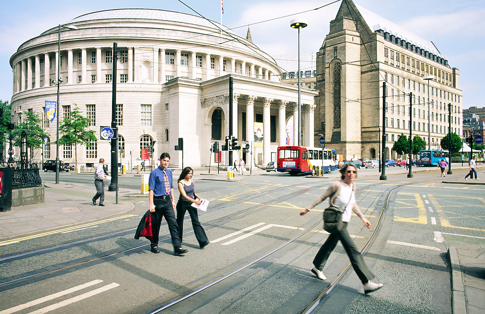 Manchester city centre.  The Central Library and Theatre, round building left, and Town Hall in St. Peters Square.