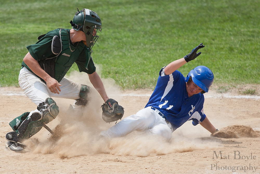 Waldo County Maine's Zach Beaudry slides safely into home under West Deptford's Jason Roselli's tag during a elimination bracket game of the Eastern Regional Senior League tournament held in West Deptford on Sunday, August 7.