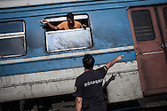 Gevgelija, Macedonia - A policeman is trying to make the arrangements and prepare a train to accept refugees and migrants that wants to travel to the Macendonian - Serbian border, on the 23rd of August 2015. Thousands of refugees (mostly coming from Syria) and migrants try every day to cross the Greek border to Macedonia (Fyrom), hoping to continue their journey to Central/North Europe and eventualy reach countries like Germany, Great Britain and Sweden.