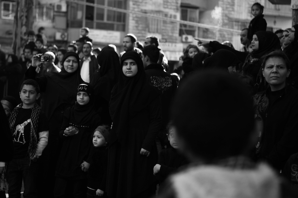 The Day of Ashoura brings many people onto the streets of their neighborhood.