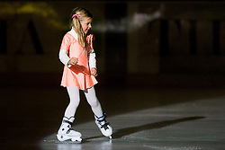 Young figure skating girl during ice-hockey match between HD Tilia Olimpija and HK Acroni Jesenice  in 6th Round of EBEL league, on September 26, 2010 at Hala Tivoli, Ljubljana, Slovenia. (Photo By Matic Klansek Velej / Sportida.com)