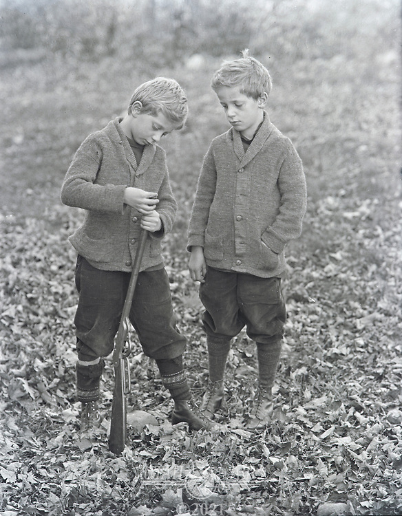 Boys loading BB gun early 1900's
