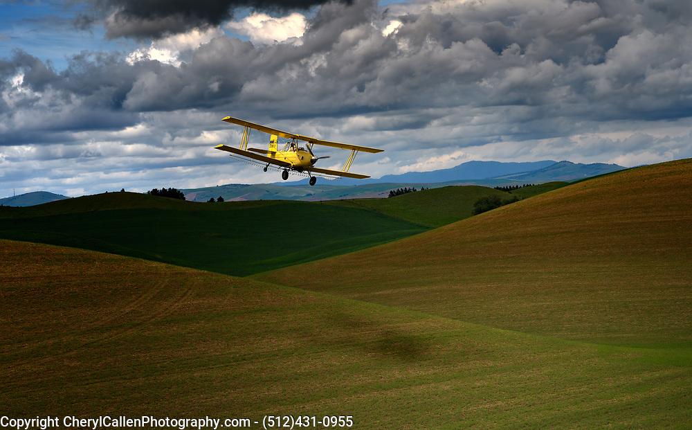 Crop duster in Palouse region