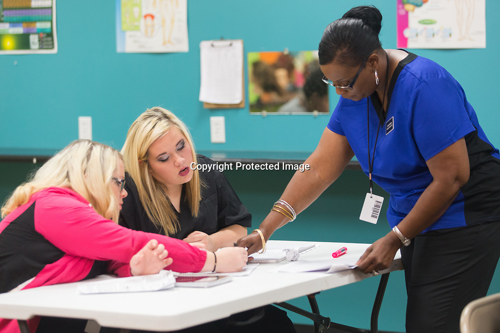 Student instructor Leslie Marion, right, goes over a study review question with students Melody Smith, left, and Mary Sheffield, center, in the freshman level classroom at the Tupelo Academy of Cosmetology. The school has locations in Tupelo, Corinth and most recently Aberdeen.