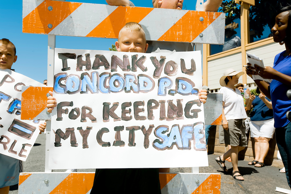 Two young boys show support for local police departments at Johannes Mehserle rally in Walnut Creek, CA.  Copyright 2010 Reid McNally.