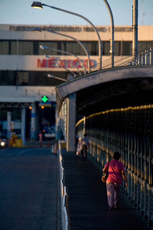 Pedestrians cross into Mexico on August 20, 2010 in Laredo, Texas. A decrease in tourism to Mexico also means a decrease in tourism to South Texas. City officials say negative attitudes about the city's more dangerous sister Nuevo Laredo have kept tourists from coming and effected the over all economics of the town.