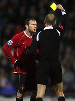 Photo: Paul Thomas.<br /> Blackburn Rovers v Manchester United. The Barclays Premiership. 11/11/2006.<br /> <br /> Wayne Rooney of Man Utd gets yellow card from Referee Mr M. Riley.