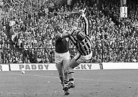 974-12<br />  'Oops!' Limerick full-back Pat Hartigan (left) and Kilkenny's Pat Delaney lose their balance in this tussle.<br /> All-Ireland Hurling Final at Croke Park. 1/9/74<br /> Pic: Matt Walsh<br />   (Part of the Independent Newspapers Ireland/NLI collection.)