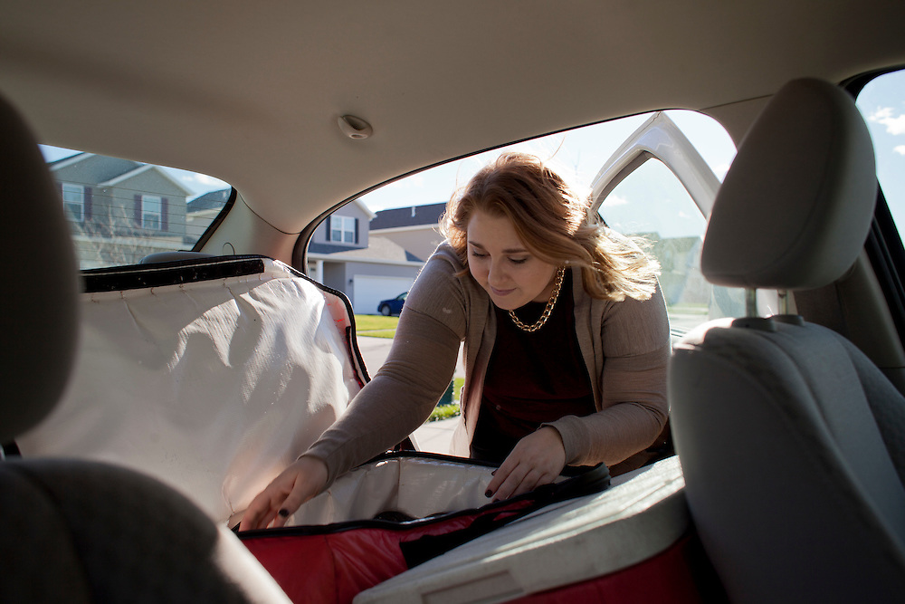 "Horizons volunteer coordinator Anna Ronnebaum retrieves a Meals on Wheels lunch from the back of her car at a stop on her route in Cedar Rapids on Thursday, November 19, 2015. Ronnebaum is new to the position, but says she wanted to work somewhere she felt she could help the community. ""We see the people on our route day after day, so we can check on how well they're doing and if they might need some help. I'm learning a lot about people by doing this and I love getting to hear their stories,"" she says.  (Rebecca F. Miller/Freelance for The Gazette)"