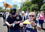 From left, Ed Tolon and Connie Tolon of Trevose, Pennsylvania release butterflies during a butterfly release and memorial at Kirk and Nice Funeral Home Sunday May 8, 2016 in Feasterville, Pennsylvania.  (Photo by William Thomas Cain)