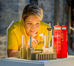 Exhibition &amp; Events Officer with the New Lanark Trust Evelyn Whitelaw checks over one of the exhibition pieces all made entirely from Lego bricks, which goes on display to the public at the New Lanark World Heritage Village from today. <br /> <br /> &copy; Dave Johnston/ EEm