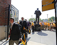 August 31 2013: The Iowa Hawkeyes walk in past the statue of Nile Kinnick before the start of the NCAA football game between the Northern Illinois Huskies and the Iowa Hawkeyes at Kinnick Stadium in Iowa City, Iowa on August 31, 2013. Northern Illinois defeated Iowa 30-27.