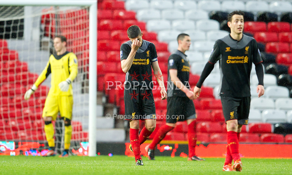MANCHESTER, ENGLAND - Tuesday, May 14, 2013: Liverpool's captain Conor Coady looks dejected as Manchester United score the third goal during the Premier League Academy Elite Group Semi-Final match at Old Trafford. (Pic by David Rawcliffe/Propaganda)
