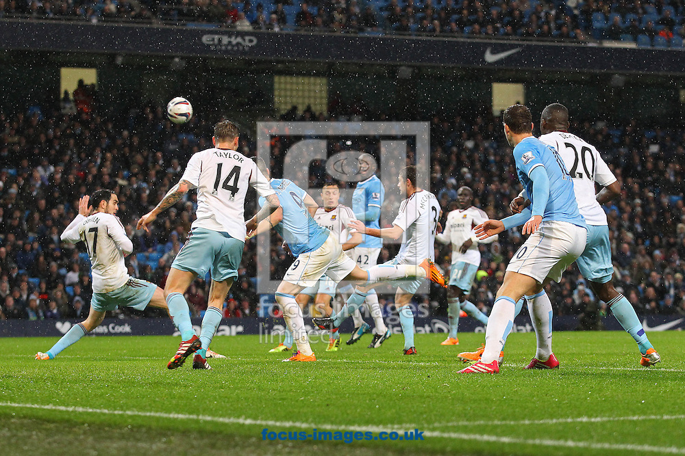 Picture by Paul Chesterton/Focus Images Ltd +44 7904 640267<br /> 08/01/2014<br /> Goalmouth action during the Capital One Cup Semi Final 1st Leg match at the Etihad Stadium, Manchester.