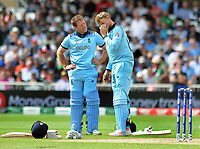 Cricket - 2019 ICC Cricket World Cup - Group Stage: England vs. Pakistan<br /> <br /> Eoin Morgan checks on Joe Root of England,after getting a fly in his eye at Trent Bridge, Nottingham.<br /> <br /> COLORSPORT/ANDREW COWIE