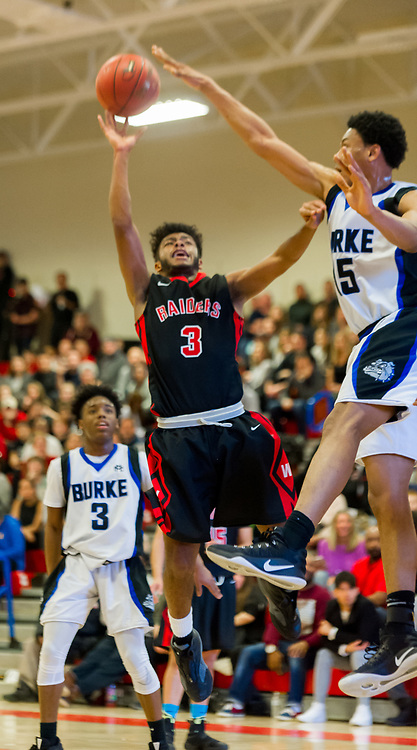 Watertown High School senior Julian Fulcar goes to the basket during the MIAA Division 3 state semifinal game against Jeremiah E. Burke High School in Burlington, March 14, 2018. The Raiders won the game, 66-61. [Wicked Local Photo/James Jesson]