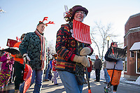 "Dorothy Duffy is one ""happy shoveler"" marching with the Snow Shovelers Brigade down Main Street during the Holiday Parade on Saturday afternoon.  (Karen Bobotas/for the Laconia Daily Sun)"
