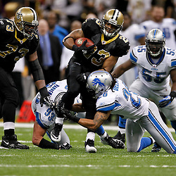 January 7, 2012; New Orleans, LA, USA; New Orleans Saints running back Pierre Thomas (23) is tackled by Detroit Lions safety Louis Delmas (26) during the 2011 NFC wild card playoff game at the Mercedes-Benz Superdome. Mandatory Credit: Derick E. Hingle-US PRESSWIRE