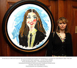 Artist STELLA VINE with one of her controversial paintings at an exhibition in London on 23rd March 2004.PSS 259