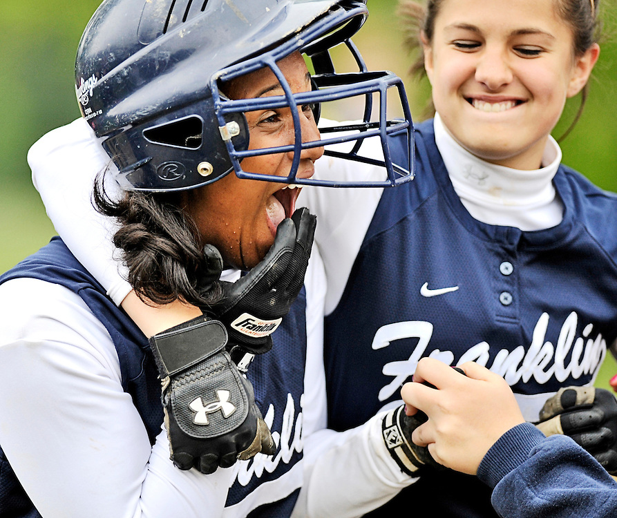 (staff photo by Matt Roth)..Franklin freshman Kimberly Dorsey, left, celebrates with sophomore Mary Sobota, left, and her other teammates in the dugout after scoring the go-ahead run in the top of the 7th inning. Catonsville lost to guest Franklin 1-2 Wednesday, May 6, 2009, during the Baltimore County Championship game at Catonsville High School.