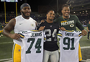 Aug 22, 2019; Winnipeg, Manitoba, CAN; Oakland Raiders defensive back Johnathan Abram (24) poses with Green Bay Packers offensive guard Elgton Jenkins (74) and outside linebacker Preston Smith (91) after the game at Investors Group Field. The Raiders defeated the Packers 22-21.