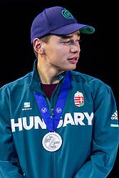 12-01-2019 NED: ISU European Short Track Championships 2019 day 2, Dordrecht<br /> Shaolin Sandor Liu of Hungary pose in the Men's 500m medal ceremony during the ISU European Short Track Speed Skating Championships
