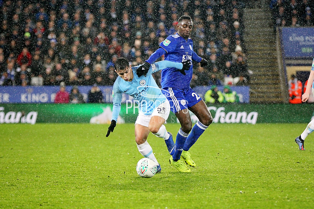 Manchester City's Brahim Diaz (55) and Leicester City midfielder Onyinye Wilfred Ndidi (25) during the quarter final of the EFL Cup match between Leicester City and Manchester City at the King Power Stadium, Leicester, England on 18 December 2018.