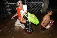 Habitantes de Puerto parada evacuan debido las inundaciones causadas por la ruptura de una borda del Río Grande  Junio de 2010 ganado debido a las Inundaciones por el paso de la tormenta Tropical Agatha. Segun datos del Ministerio de Agricultura las perdidas en la agricultura y la ganaderia asenderan 4 millones. IL photo/Roberto Marquez