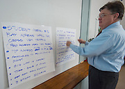 Project advisor team members for Wilson Montessori confer about design options during a design charrette, April 29, 2015.