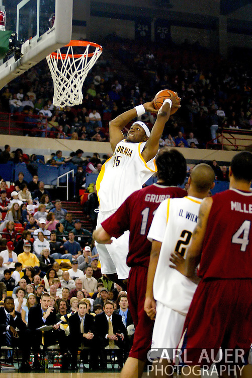 11/25/2006 - Anchorage, Alaska: Everyone just stands and watches as Junior center DeVon Hardin (35) of the California Golden Bears slams another 2 points home as the California Golden Bears beat LMU 78-70 to capture the championship title of the 2006 Great Alaska Shootout<br />