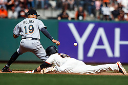 SAN FRANCISCO, CA - APRIL 24: Buster Posey #28 of the San Francisco Giants dives into second base for a double ahead of a tag from Miguel Rojas #19 of the Miami Marlins during the seventh inning at AT&T Park on April 24, 2016 in San Francisco, California. The Miami Marlins defeated the San Francisco Giants 5-4. (Photo by Jason O. Watson/Getty Images) *** Local Caption *** Buster Posey; Miguel Rojas