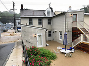 Ellicott City, Maryland - May 27, 2018: Floodwaters rage down Main Street in Historic Ellicott City, and ruin property.<br /> <br /> Historic Ellicott City Maryland was destroyed by floodwaters Sunday May 27, 2018 -- the same day of Kristen Rigney and Craig Cymbor's wedding at Main Street Ballroom in Ellicott City. Their wedding venue flooded minutes before their ceremony was scheduled and the entire wedding party fled to La Palapa, the Mexican food restaurant upstairs, where Craig and Kristen said their vows. Instead of eating, drinking and dancing, the wedding party, watched cars get swept away. <br /> CREDIT: Matt Roth