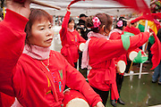 Drummers drumming in the Year of the Dragon in New York's Chinatown. The noise of the drums sends bad spirits away.