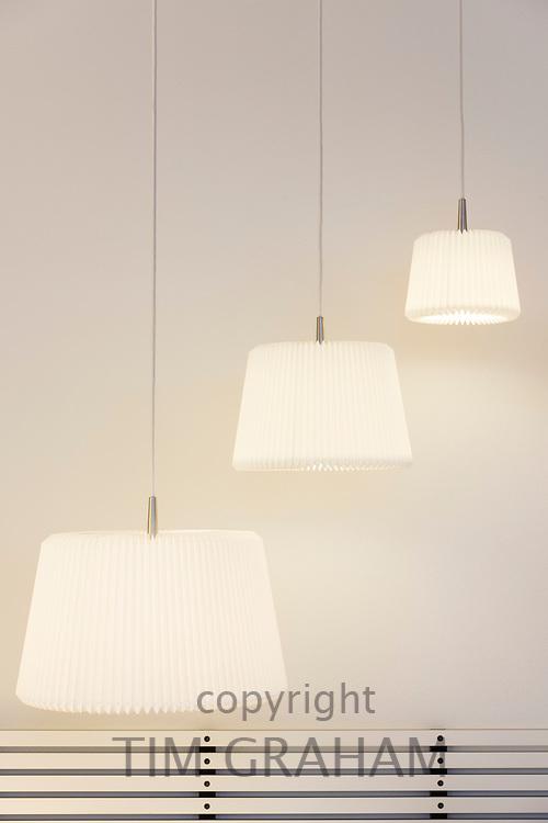 Le Klint Danish contemporary pendant lights in lighting emporium in Kirkestraede in old district Copenhagen, Denmark