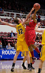 March 20, 2010; Stanford, CA, USA;  Rutgers Scarlet Knights guard Brittany Ray (35) is defended by Iowa Hawkeyes center Morgan Johnson (12) during the first half in the first round of the 2010 NCAA womens basketball tournament at Maples Pavilion.  Iowa defeated Rutgers 70-63.