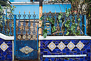 A home along the Escadaria Selaron or Selaron Steps, public art work made from thousands of tile mosaic set in a stairway between Lapa and Santa Teresa neighborhoods in Rio de Janeiro, Brazil. The steps are a creation and work of Chilean-born artist Jorge Selaron.