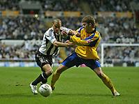 Photo: Andrew Unwin.<br />Newcastle United v Southampton. The FA Cup. 18/02/2006.<br />Southampton's Martin Cranie (R) looks to tacke Newcastle's Kieron Dyer (L).