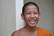 Portrait of a smiling young Buddhist priest in Vang Vieng, Laos