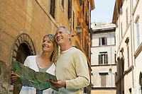 Couple on street with map in Rome Italy low angle view