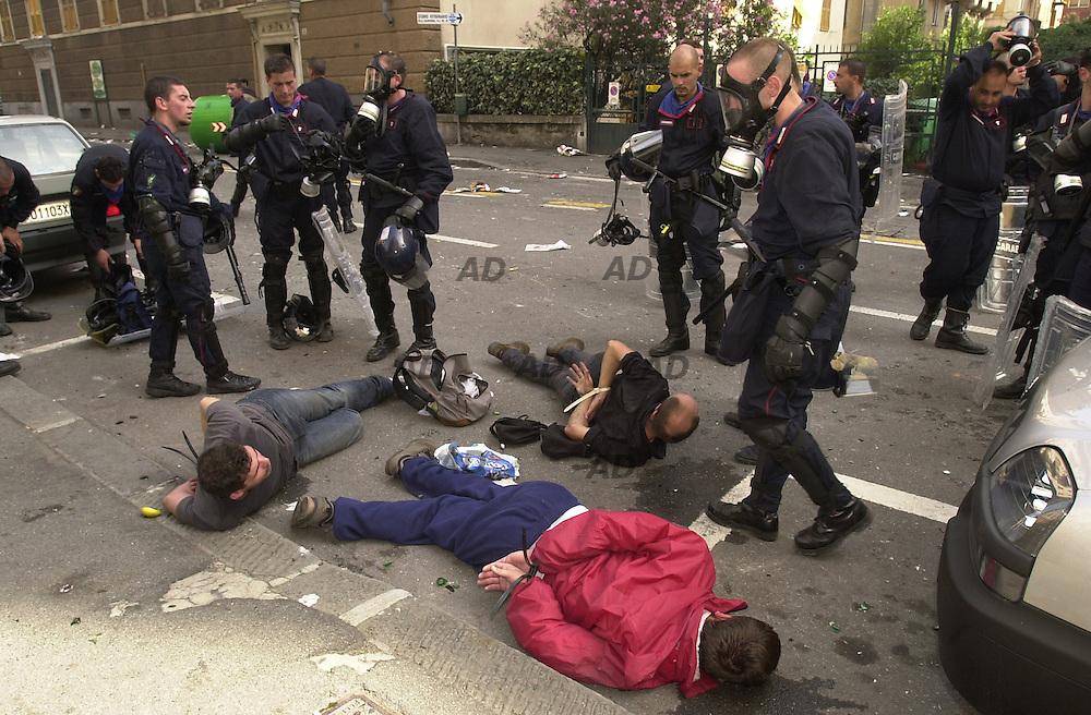 Carabinieri arrest some protester.