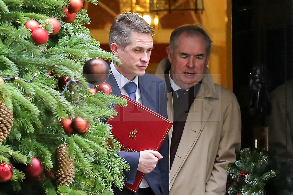 "© Licensed to London News Pictures. 18/12/2018. London, UK. Gavin Williamson - Secretary of State for Defence (L) and Geoffrey Cox - Attorney General (R) departs from No 10 Downing Street after attending the weekly Cabinet Meeting that discussed the preparations for a ""No Deal"" Brexit. Photo credit: Dinendra Haria/LNP"
