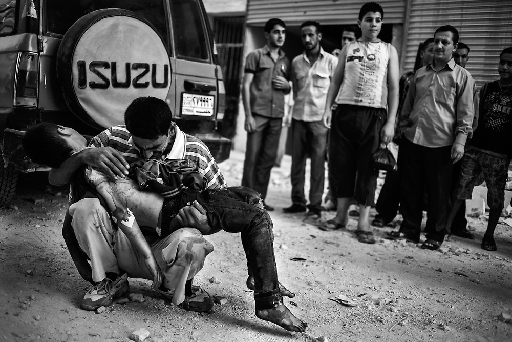 Aleppo, Syria, 2012/10/03.<br /> In front of Dar Al-Shifaa hospital.<br /> A father is mournig his son, killed by a mortar shot.