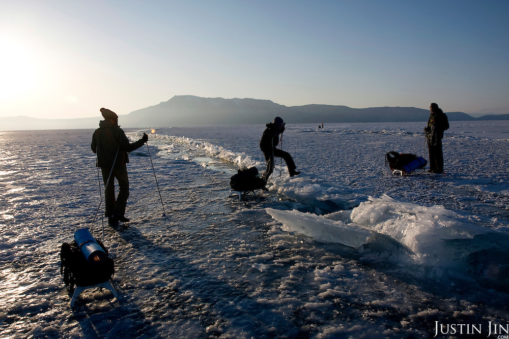 Crossing a pressure ridge on the second day trek across frozen Lake Baikal in Siberia, Russia. .They are a group of five people: Justin Jin (Chinese-British), Heleen van Geest (Dutch), Nastya and Misha Martynov (Russian) and their Russian guide Arkady. .They pulled their sledges 80 km across the world's deepest lake, taking a break on Olkhon Island. They slept two nights on the ice in -15c. .Baikal, the world's largest lake by volume, contains one-fifth of the earth's fresh water and plunges to a depth of 1,637 metres..The lake is frozen from November to April, allowing people to cross by cars and lorries.