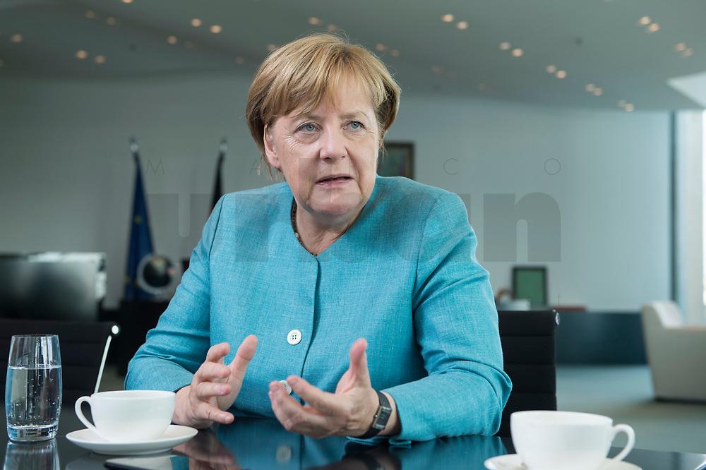 23 AUG 2017, BERLIN/GERMANY:<br /> Angela Merkel, CDU, Bundeskanzlerin, waehrend einem Interview, in Ihrem Buero, Bundeskanzleramt<br /> IMAGE: 20170823-02-011<br /> KEYWORDS: B&uuml;ro