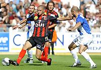 Fotball<br /> Frankrike<br /> Foto: DPPI/Digitalsport<br /> NORWAY ONLY<br /> <br /> FOOTBALL - FRENCH CHAMPIONSHIP 2009/2010 - L1 - US BOULOGNE v GRENOBLE FOOT 38 - 16/08/2009<br /> <br /> LAURENT AGOUAZI (BOU) / LAURENT COURTOIS (GRE)