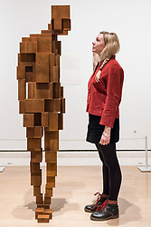 "© Licensed to London News Pictures. 07/12/2017. London, UK.  A staff member views ""Gaze III"", 2016, by Antony Gormley Preview of ""From Life"", a special exhibition at the Royal Academy examining what making art from life has meant to artists throughout history and how the practice has evolved as technology opens up new ways of creating artworks.  The exhibition runs 11 December to 11 March 2018.  Photo credit: Stephen Chung/LNP"
